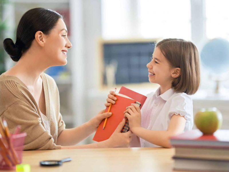 girl-with-teacher-in-classroom-67QR53S